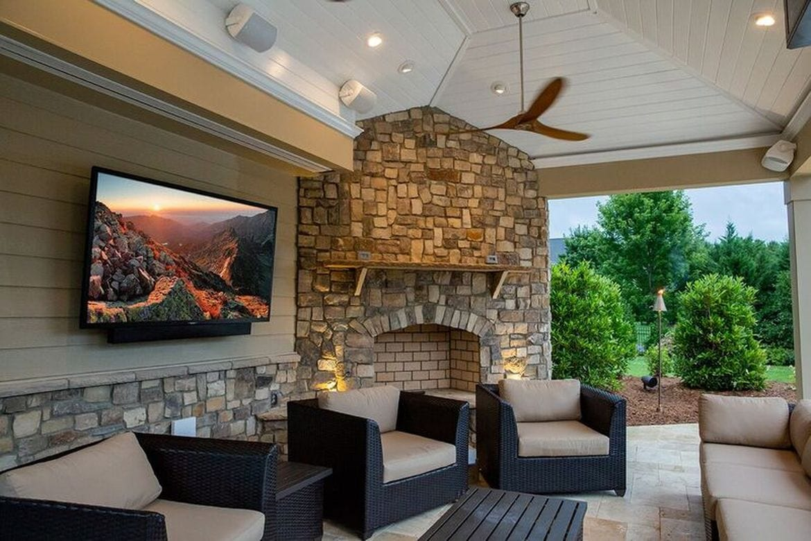 SunBrite outdoor TV on a patio with fireplace