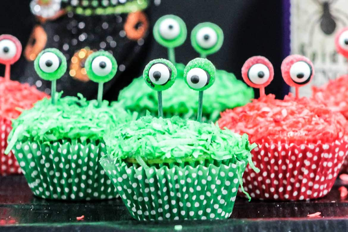 red and green alien cupcakes with eyes on a stalk