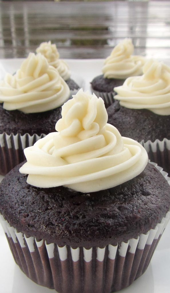 old fashioned buttercream icing on chocolate cupcake