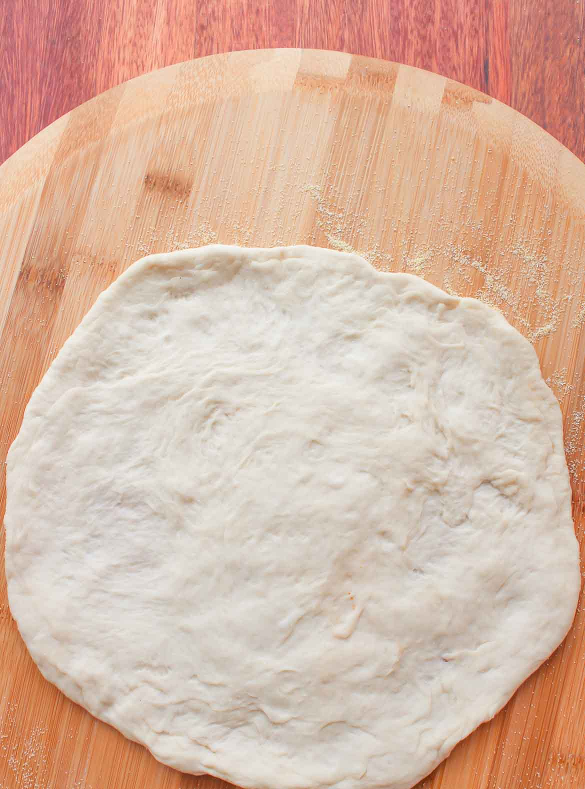 rustic pizza dough ready for toppings