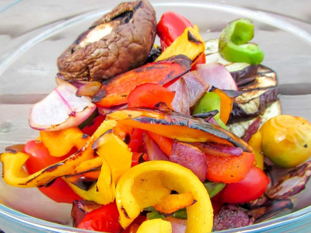 grilled mixed vegetables grilled in basket with bell peppers, onion, garlic, portabella mushroom and eggplant.