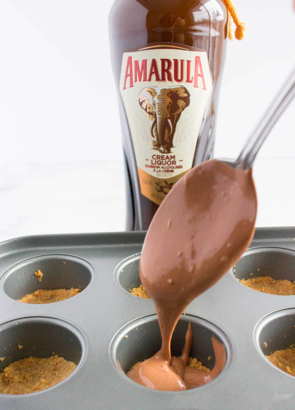adding filling to mini chocolate cheesecake bites
