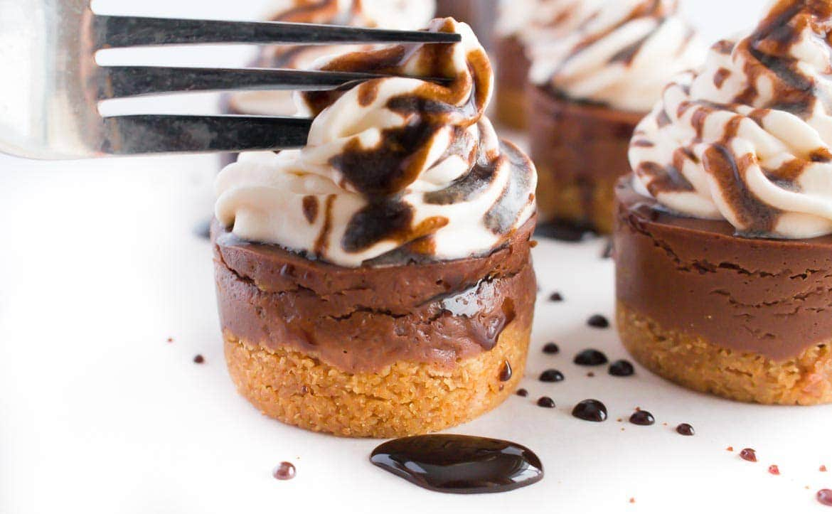 fork cutting into chocolate mini cheesecakes