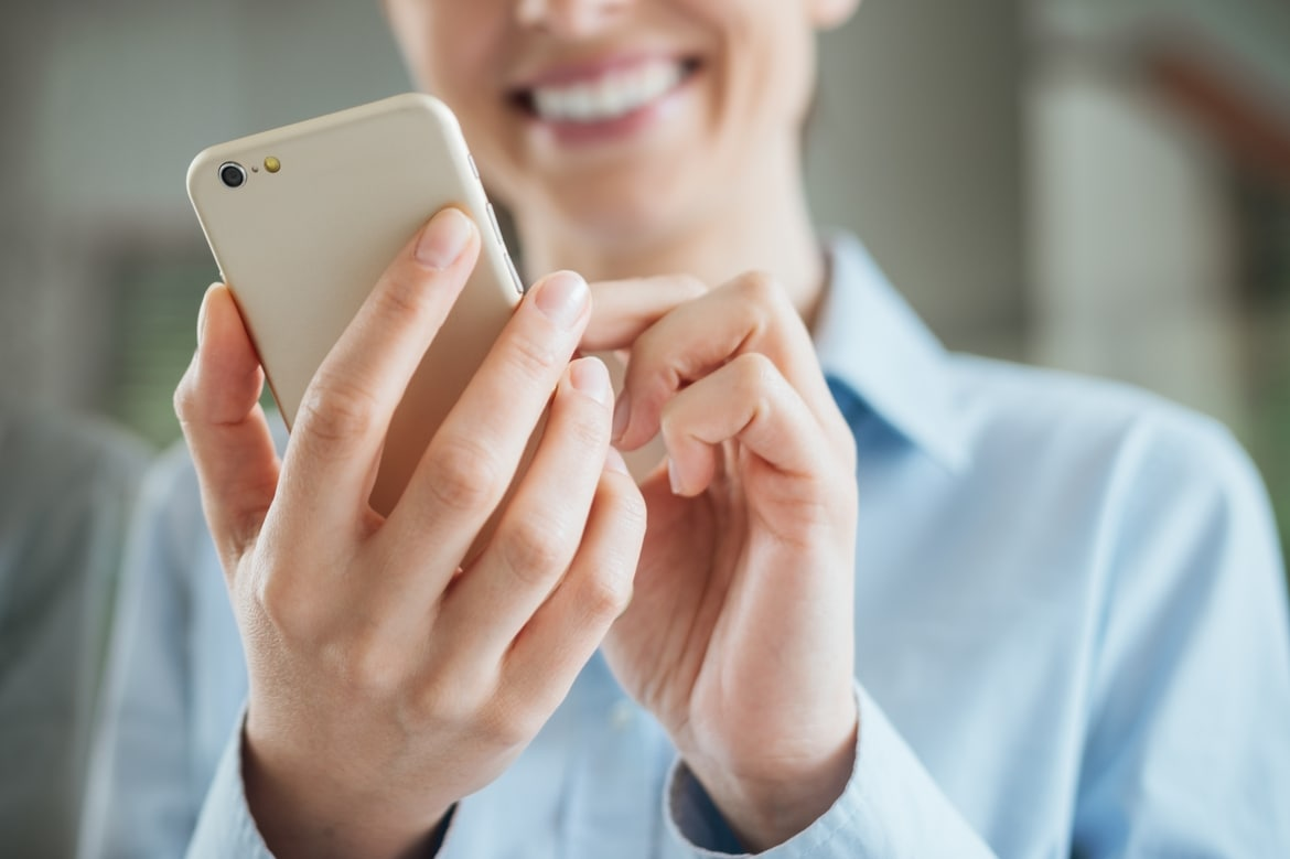 Woman on smartphone is online counseling is right for you