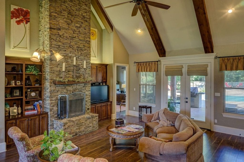 home with fireplace wood floor and wood beams