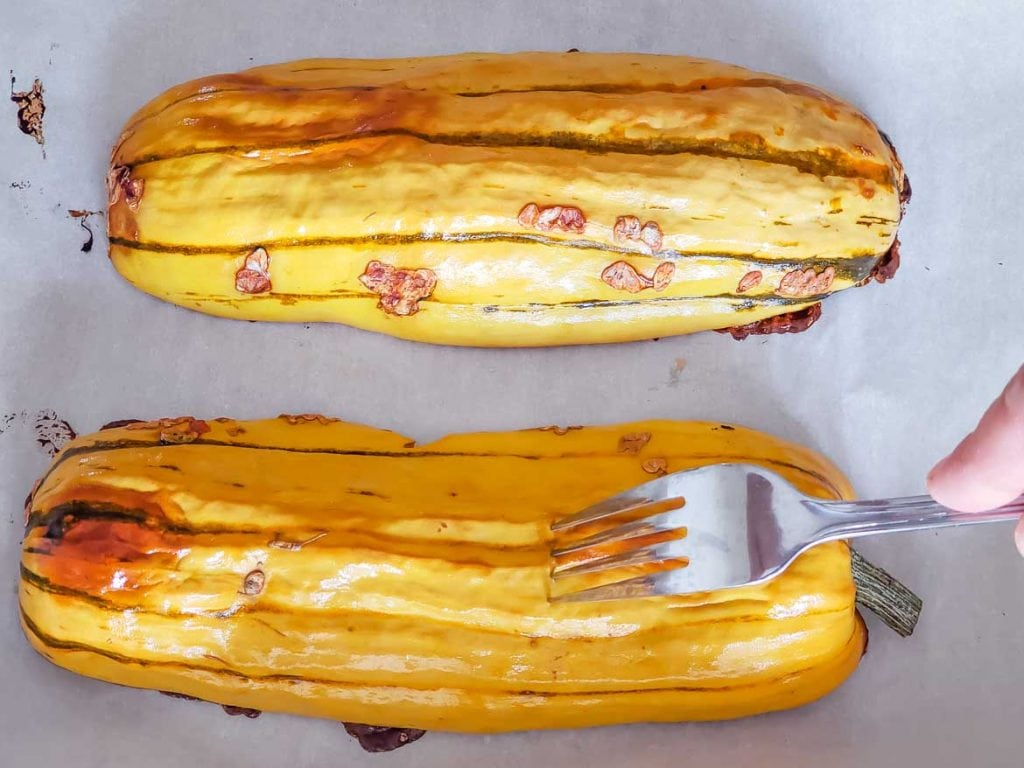 testing pan roasted delicata squash with fork to see if it's done