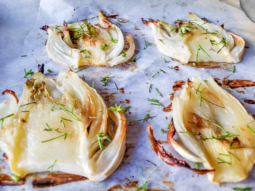 slow roasted fennel baked in oven with dill garish