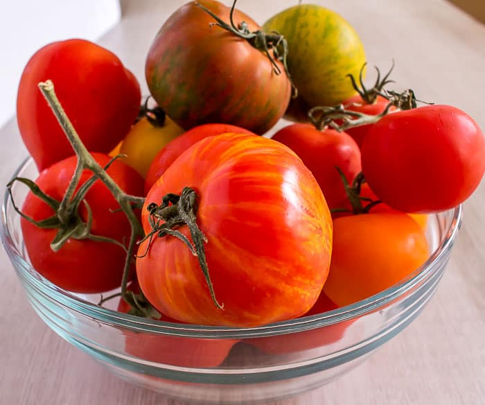 beautiful farm fresh tomatoes in a glass bowl