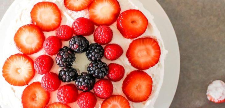 fresh fruit cake with whipped cream
