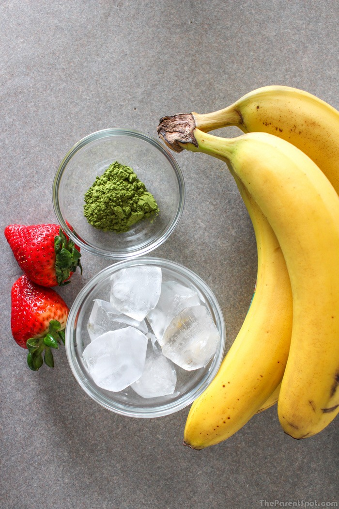 Ingredients for vegan smoothie with bananas and strawberries and matcha