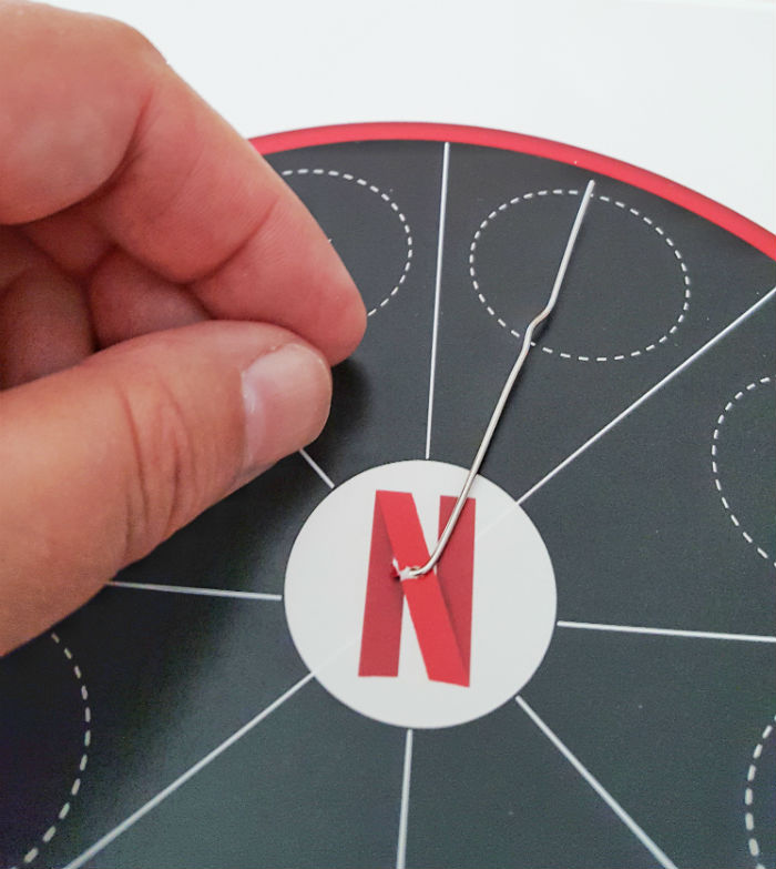 Netflix spinner paperclip on paper