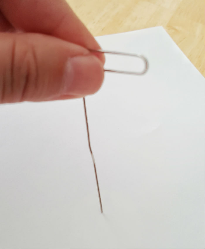 Netflix spinner paperclip poke hole in paper