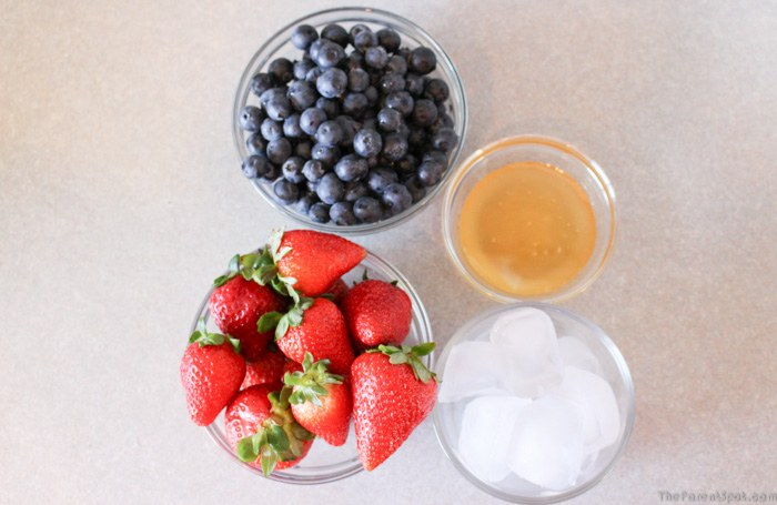 Strawberries blueberries ice and honey for Summer Berry Burst Silk Almond Smoothie