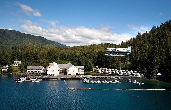 Oceanfront shot of Waterfall Resort with a seaplane landing