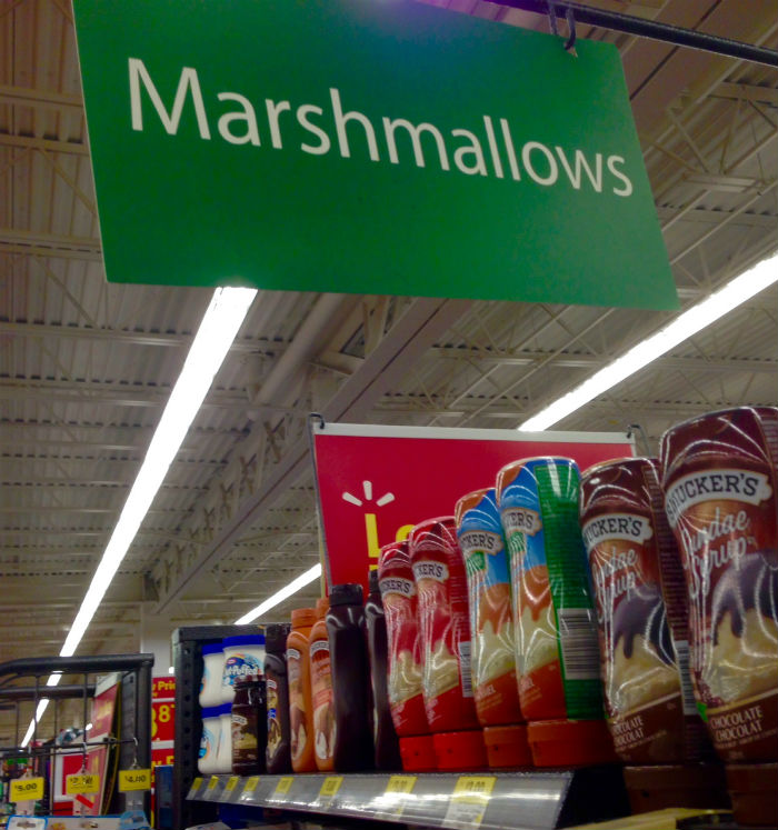 Walmart Smuckers below Marshmallows sign