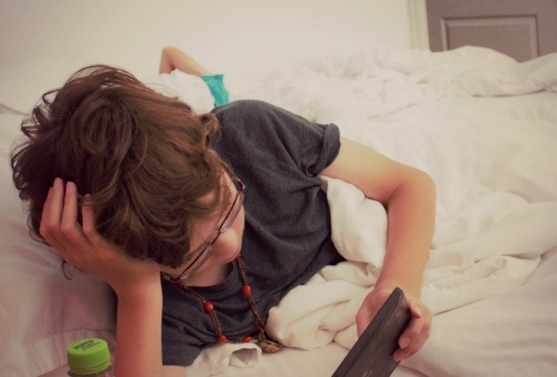 kid watching electronics